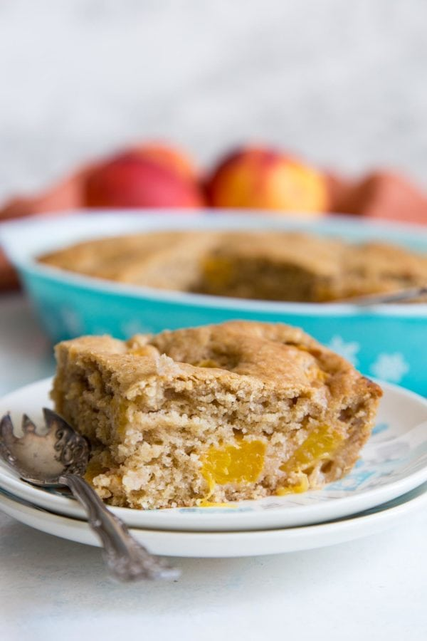 A slice of peach dump cake on a plate