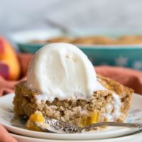 Peach dump cake with ice cream on top