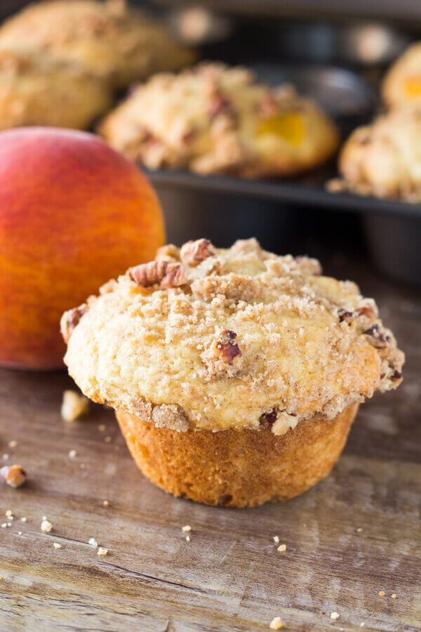 y, buttery, super soft Peach Muffins with Streusel Topping – The combo of fresh summer peaches and crunchy, cinnamon, pecan streusel makes these the perfect peach muffins!