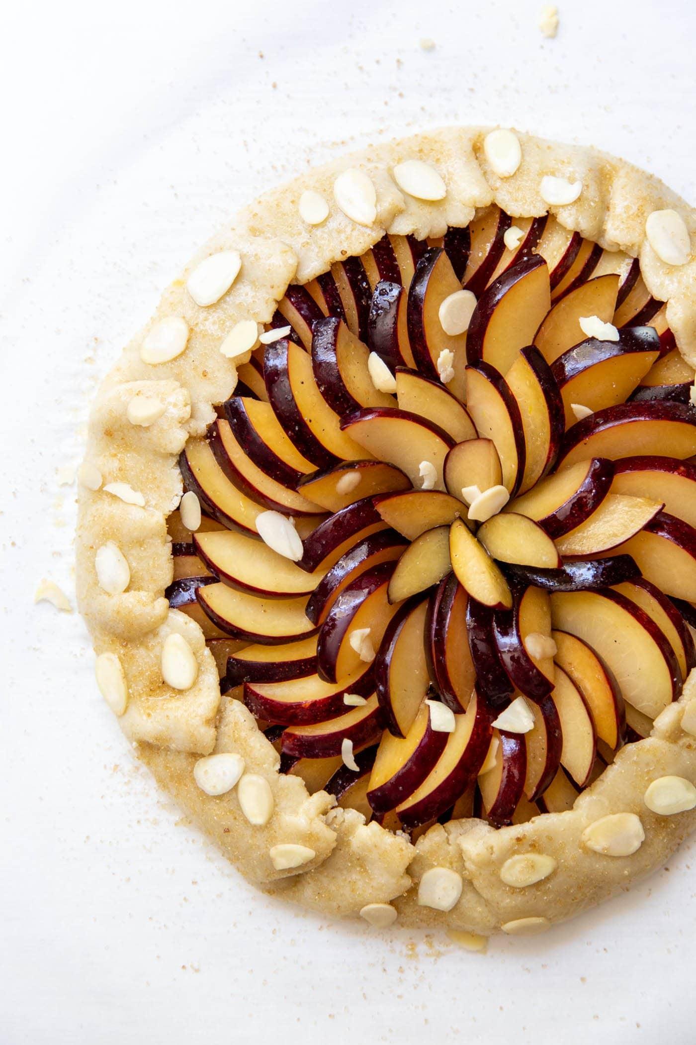 Unbaked plum galette
