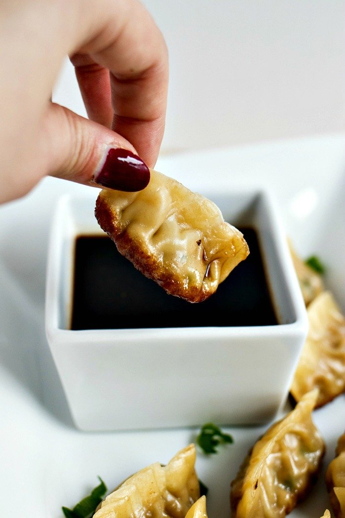 Pork Dumplings - Ground pork, garlic, ginger, and Asian spices are mixed together and stuffed in pre-made wonton wrappers to steamed to perfection to make the most amazing pork dumplings. Don't forget the Sriracha Soy Sauce for dipping!