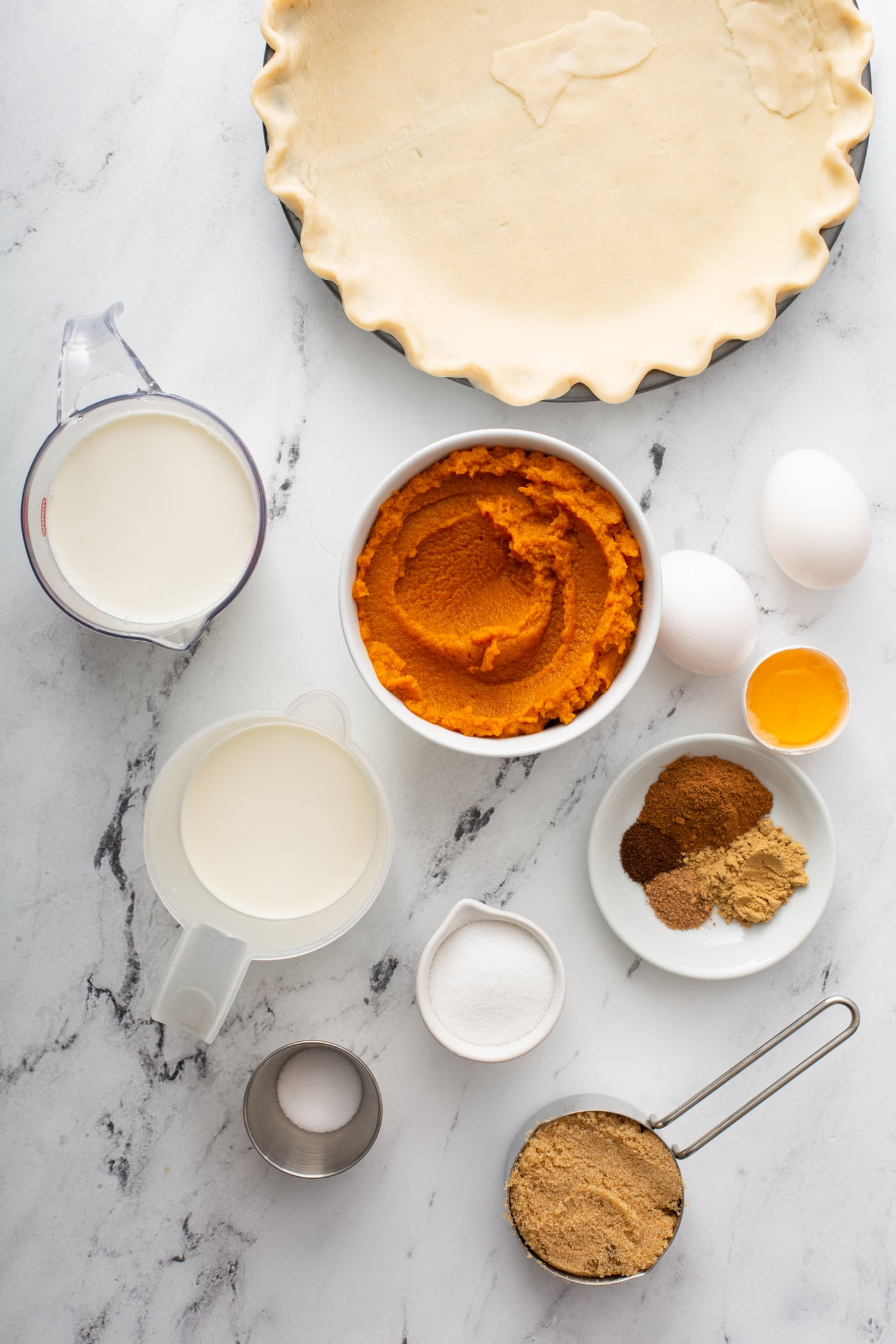 A photo of all the ingredients needed for homemade pumpkin pie.