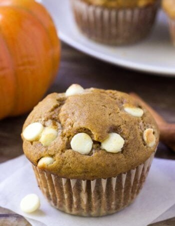 Moist, fluffy & filled with fall flavors - these pumpkin white chocolate chip muffins are the perfect breakfast or mid-morning treat!