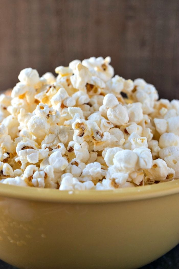 A big yellow bowl of fluffy and light Salt & Vinegar popcorn.