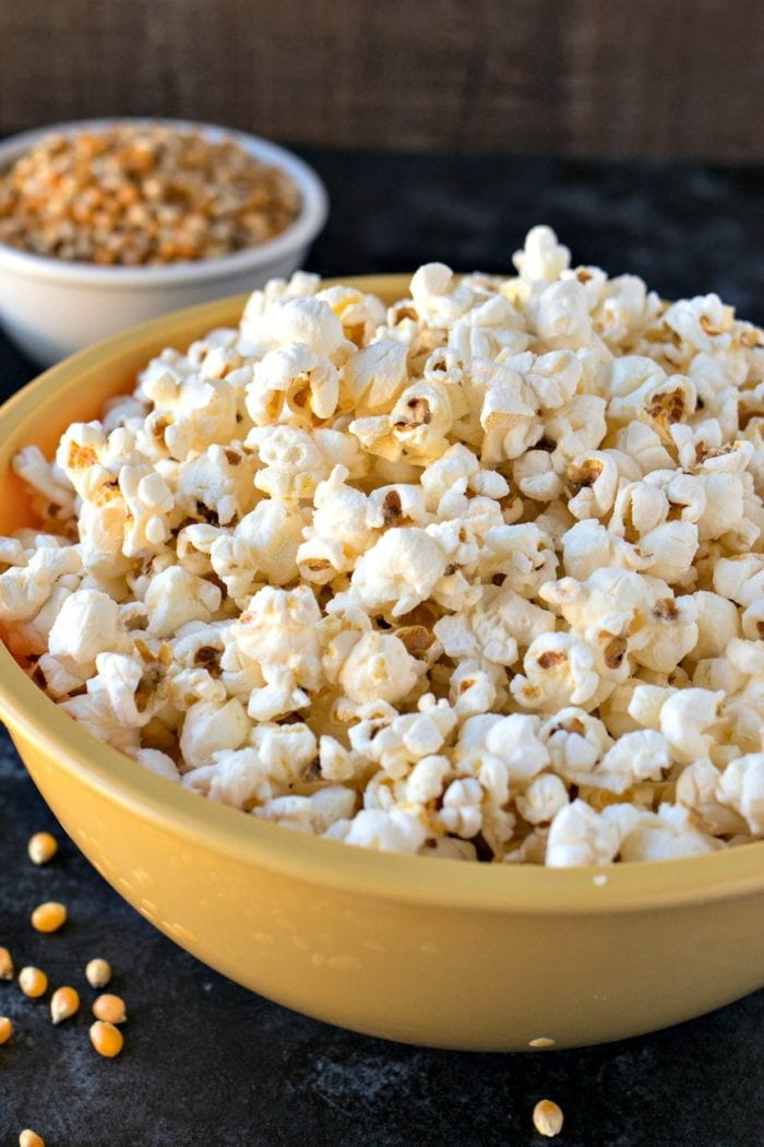 A close up of a big yellow bowl of Salt & Vinegar Popcorn.