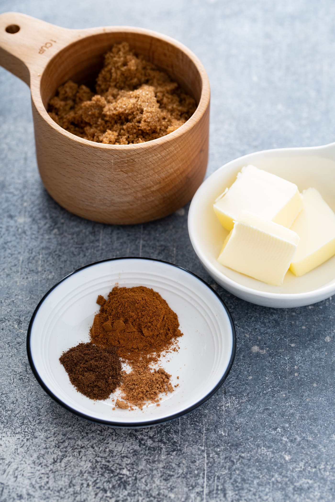 Containers of spices, butter and cinnamon.
