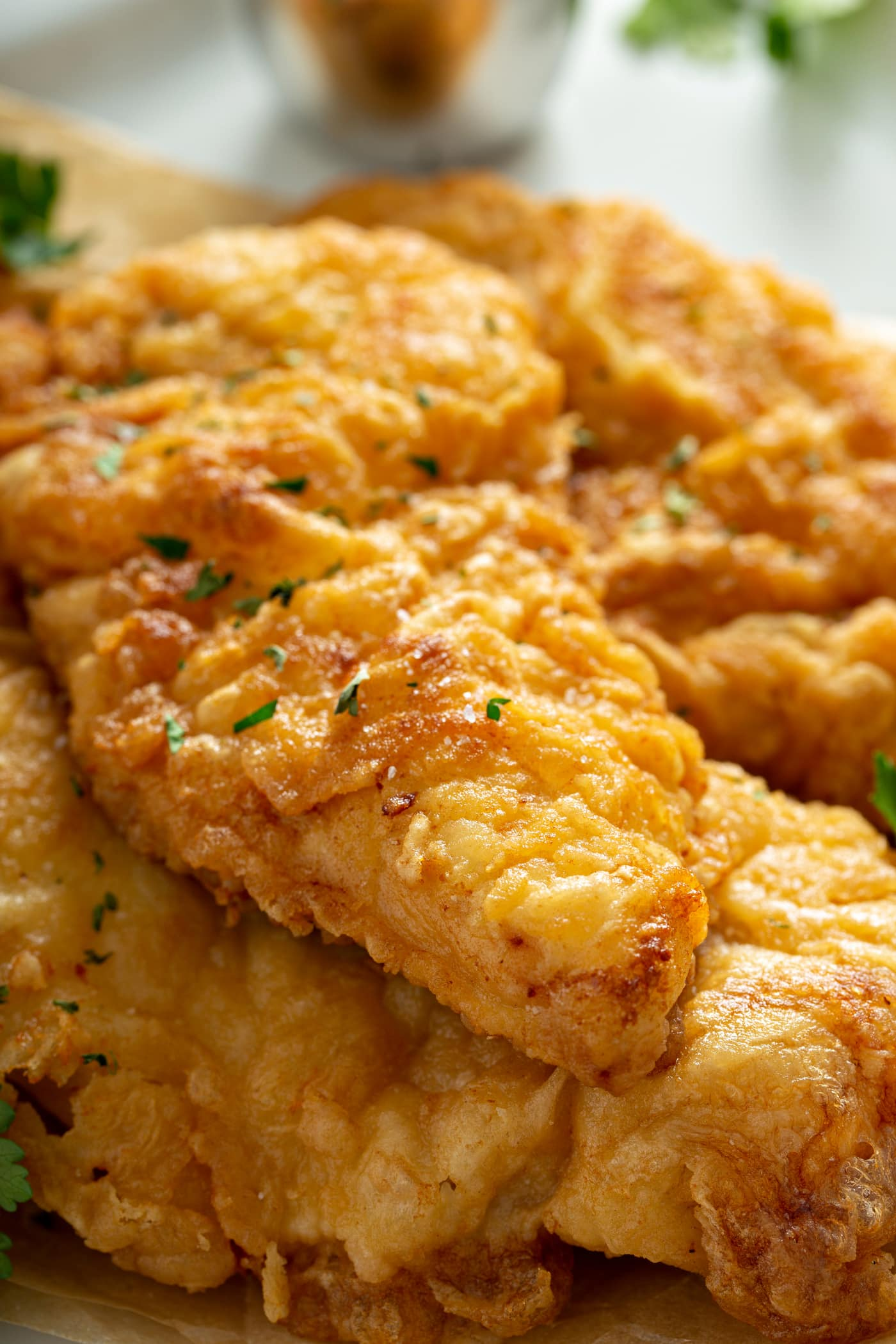 A close-up of chicken breasts that have been fried to a perfect golden brown.
