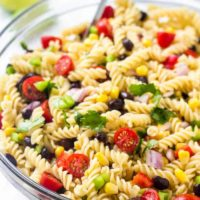 A bowl of southwest pasta salad with corn, tomatoes, black beans & cilantro