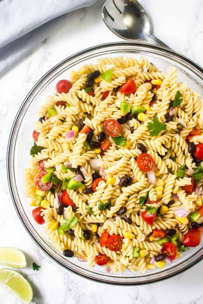 A big bowl of mexican pasta salad with chili lime vinaigrette.