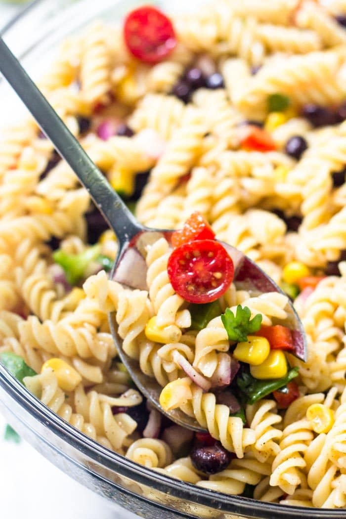 Southwest pasta salad has tomatoes, black beans, corn, peppers & cilantro in every spoonful.