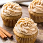 3 spice cake cupcakes topped with cinnamon cream cheese buttercream.