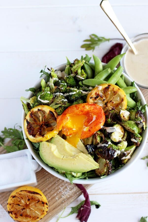 Healthy Spring Green Salad with Turmeric Poached Egg - thewoodenskillet.com