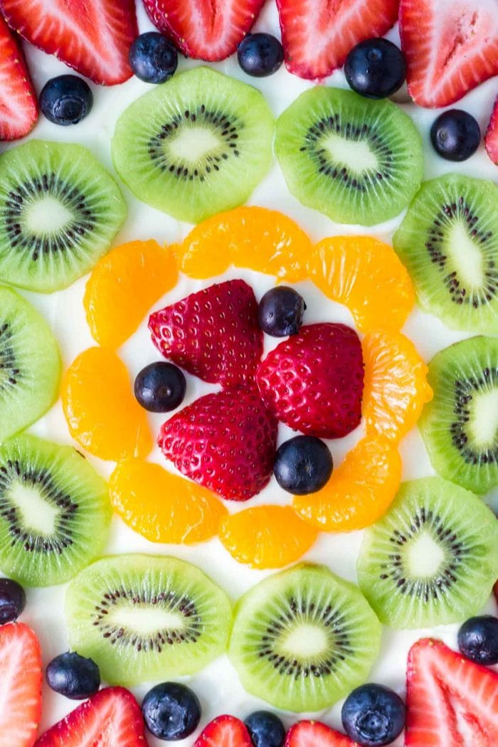 sugar cookie fruit pizza topped with assorted fresh fruit