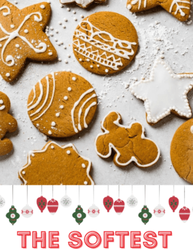 a grey board with the best soft gingerbread cookies recipe decorated with royal icing.