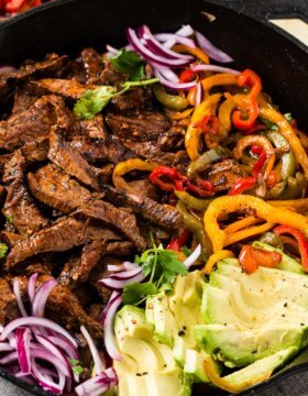 Our favorite steak fajitas marinade has a few secrets that make it extra flavorful and tender. Grilling is optional but produces even more deliciousness!