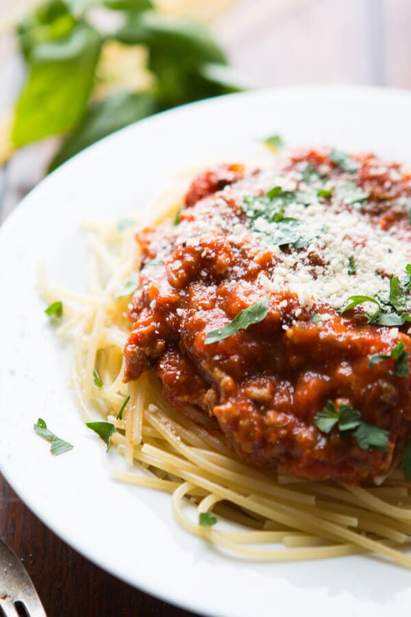 best homemade spaghetti sauce atop pasta on white plate