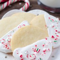 Buttery, melt in your mouth shortbread cookies infused with peppermint then dipped in chocolate and sprinkled with crushed candy canes. These white chocolate peppermint shortbread cookies are perfect for Christmas!