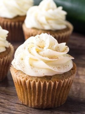 Zucchini cupcakes with cream cheese frosting are super moist with a delicious spice cake flavor and fluffy cream cheese buttercream.