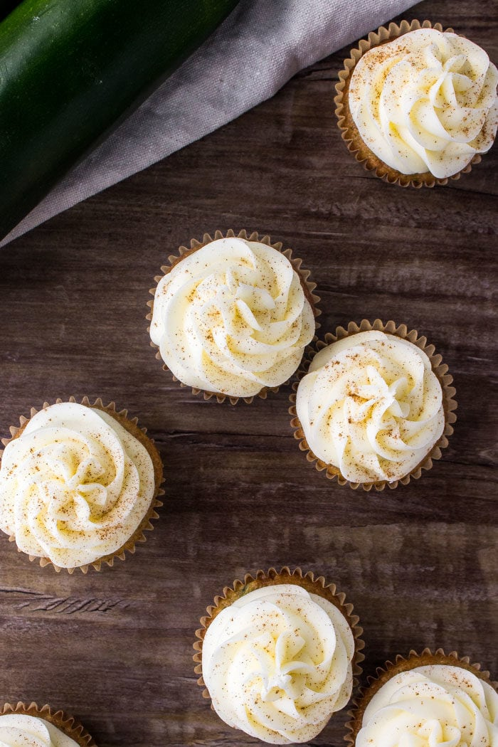 An overhead shot of zucchini cupcakes with cream cheese frosting