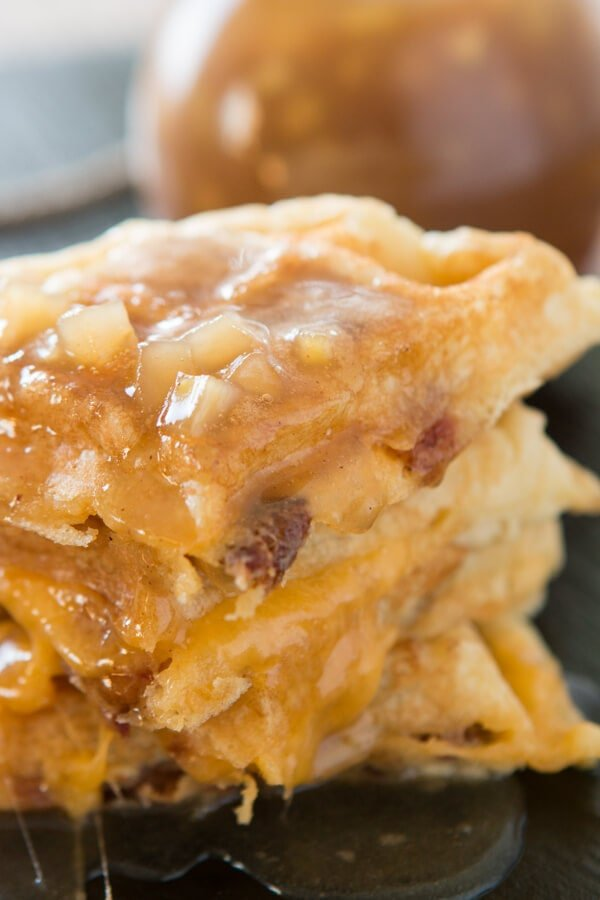 A savory apple bacon cheddar waffle with a luscious apple pie syrup! Breakfast for dinner tonight and I cannot wait to dig in! ohsweetbasil.com