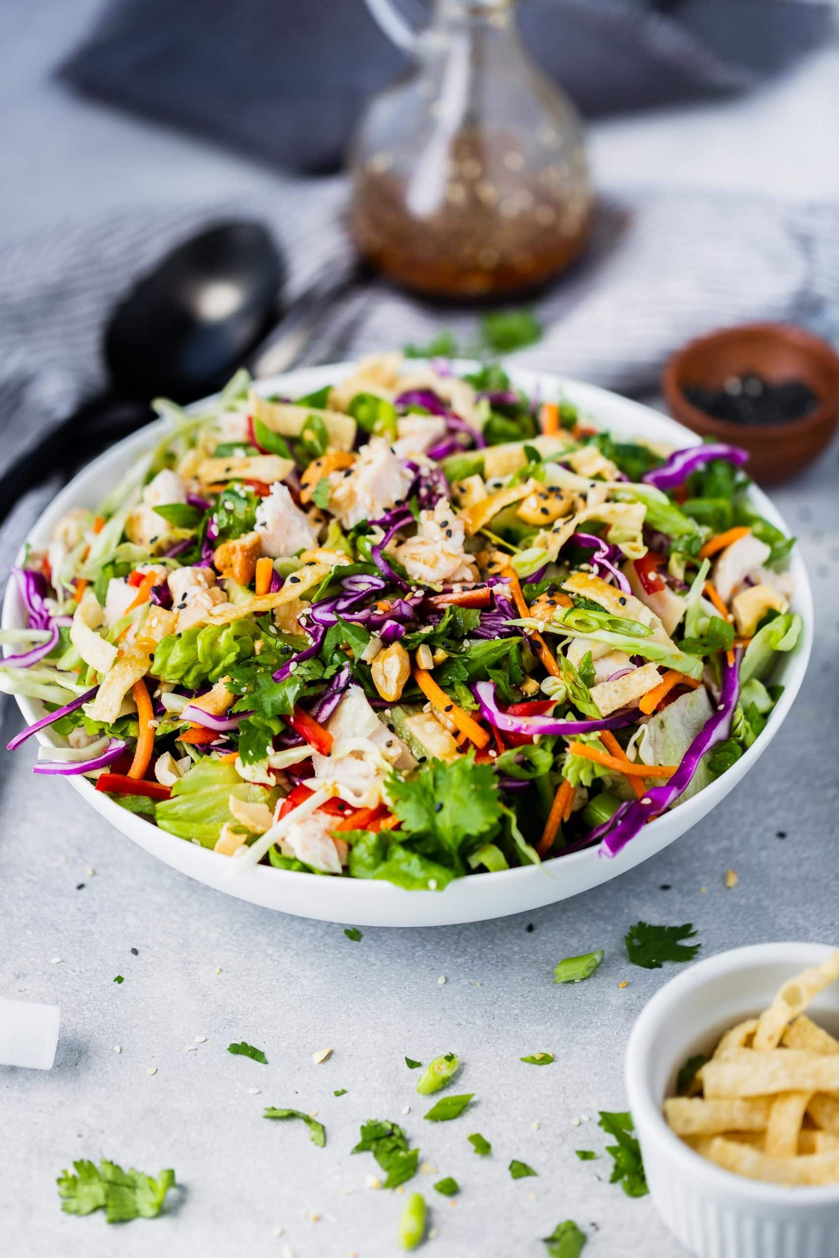 Picture of Chinese chicken salad in a large white bowl.