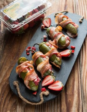We often think of strawberries for strawberry shortcake, but try this twist of bacon wrapped strawberry stuffed jalapenos for the perfect summer appetizer! ohsweetbasil.com