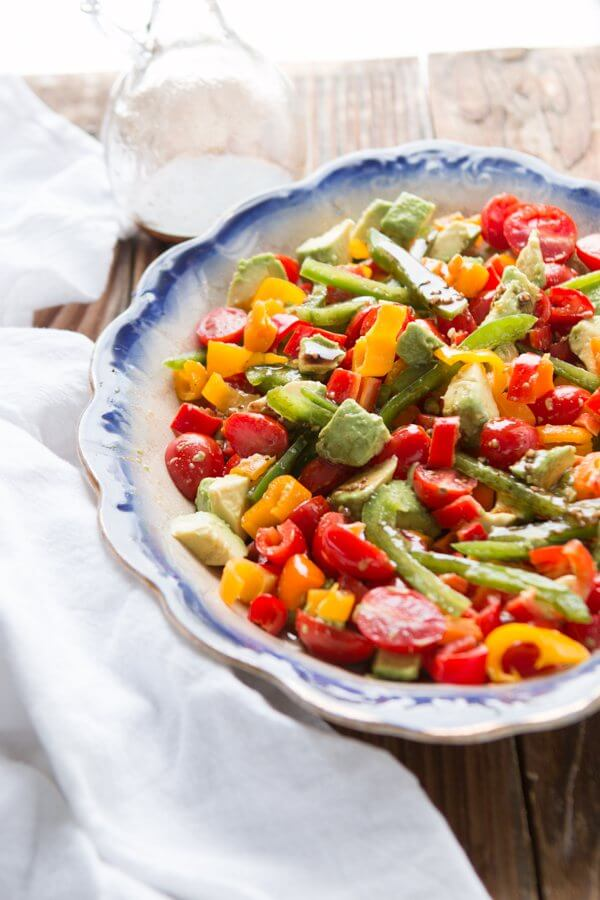 A fresh twist on a classic tomato salad, add avocado and a balsamic vinaigrette for a lovely garden balsamic avocado salad! ohsweetbasil.com Whole 30, paleo, gluten-free, dairy-free, vegetarian