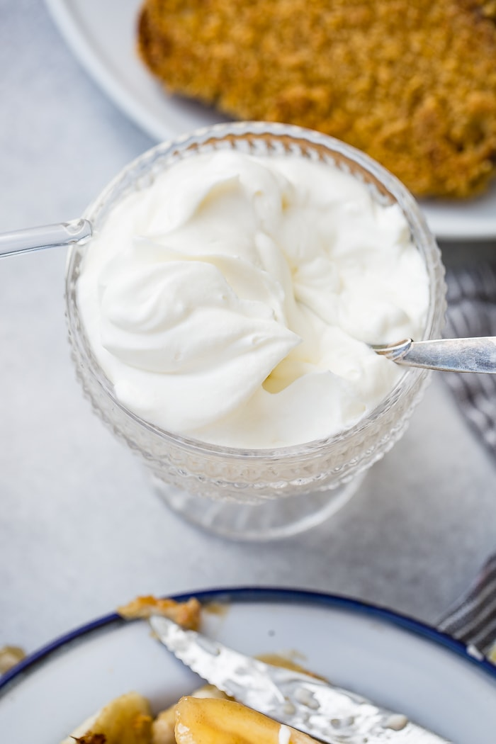 A glass dish of fresh whipped cream