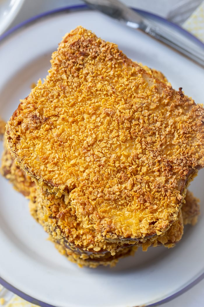 a stack of french toast coated in cornflakes
