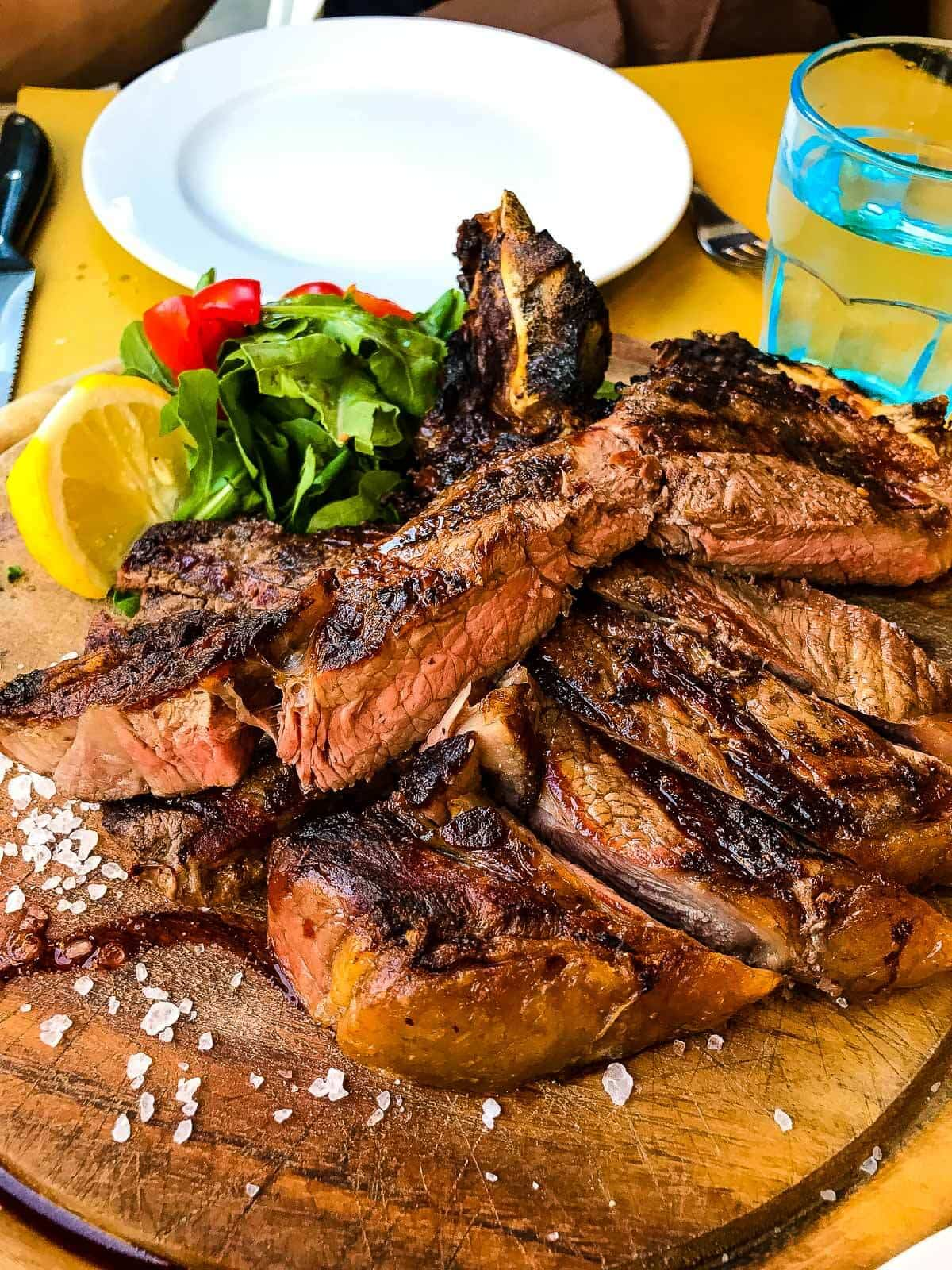 Bistecca steak is one of Florence's most famous dishes to try ohsweetbasil.com