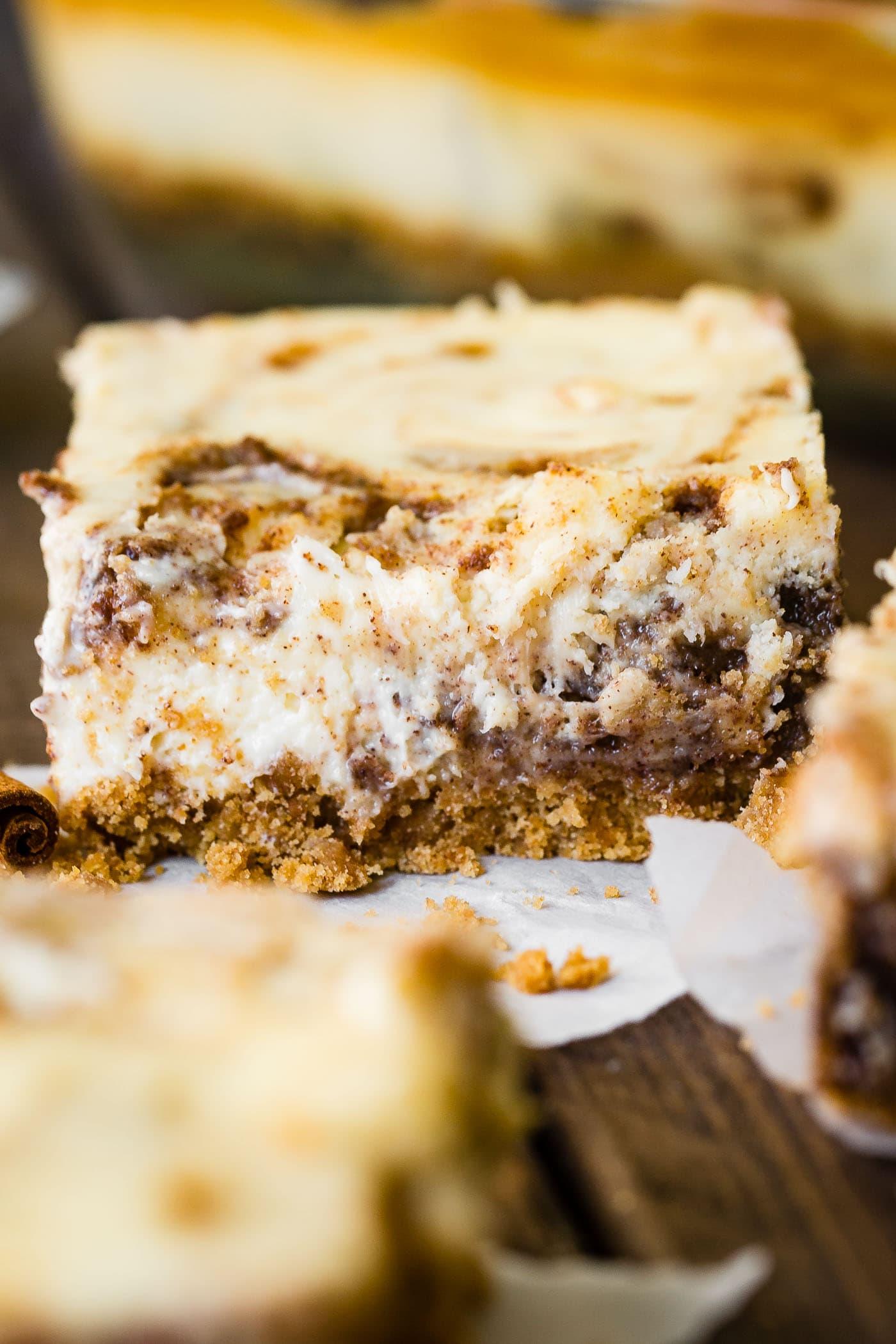 A photo of a cinnamon roll cheesecake bar.