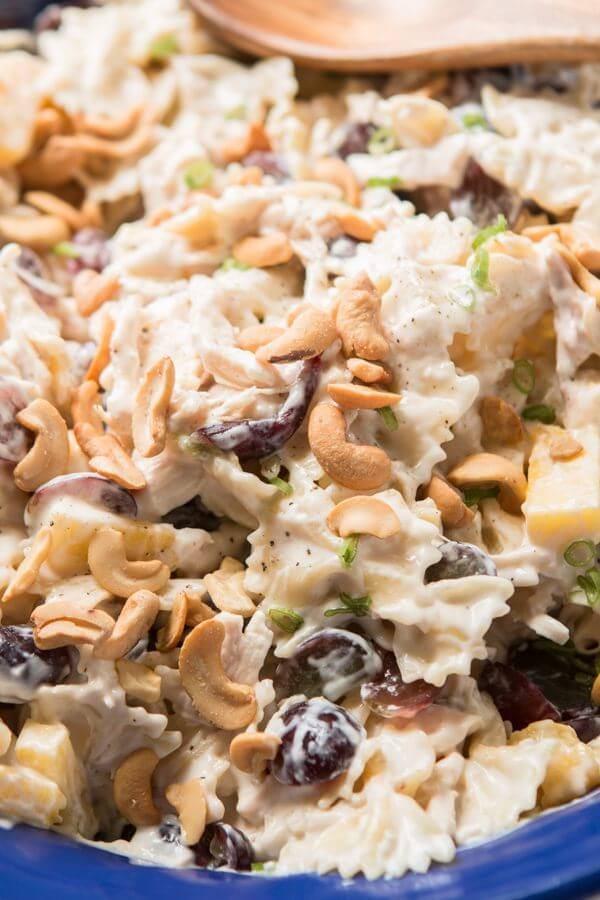 Bowtie chicken pasta salad is perfect for a BBQ. Creamy dressing, juicy pineapple and grapes, crunchy cashews and lots of chicken!