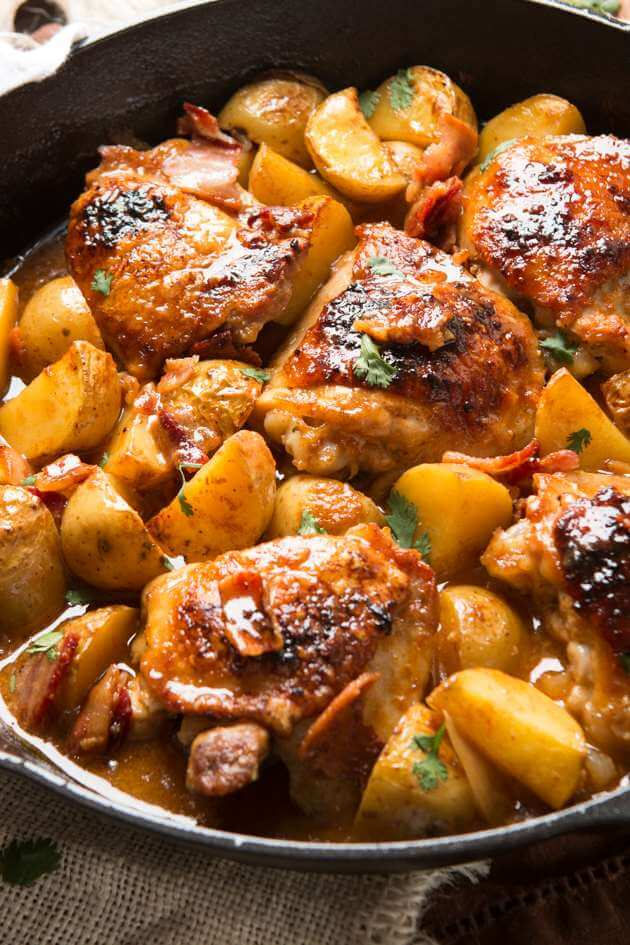 braised dijon chicken and potatoes in cast iron skillet