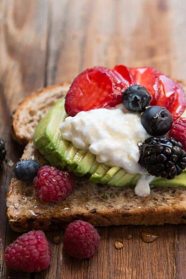 Breakfast berry avocado toast with a drizzle of honey ohsweetbasil.com
