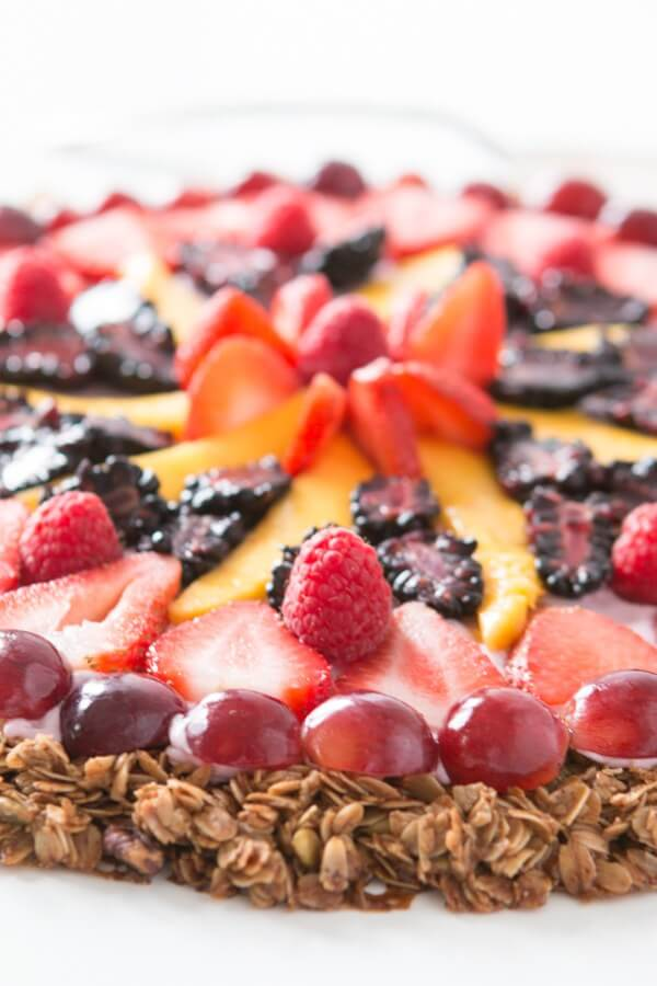 "This breakfast fruit and yogurt pizza has become one of our all time favorite recipes. Easy, crunchy granola, creamy mixed berry ""sauce"" and fruit! ohsweetbasil.com"