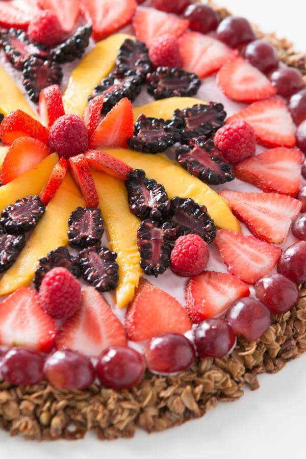 "This breakfast fruit and yogurt pizza has become one of our all time favorite recipes. Easy, crunchy granola, creamy mixed berry ""sauce"" and fruit! dessert"