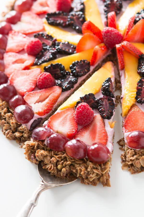 "This breakfast fruit and yogurt pizza has become one of our all time favorite recipes. Easy, crunchy granola, creamy mixed berry ""sauce"" and fruit! ohsweetbasil.com dessert"