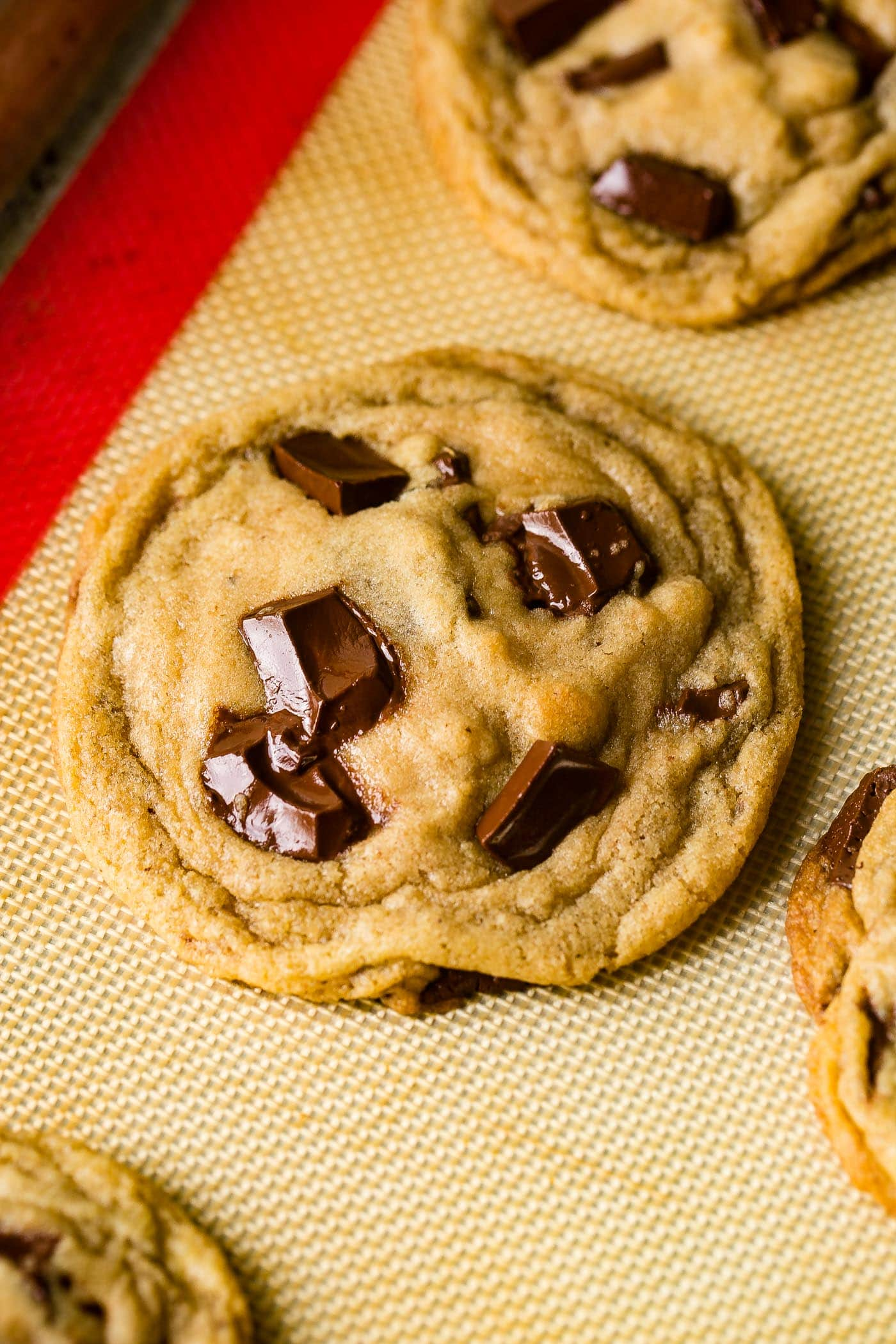a perfect chocolate chip cookie made with melted butter and big chunks of semi sweet chocolate