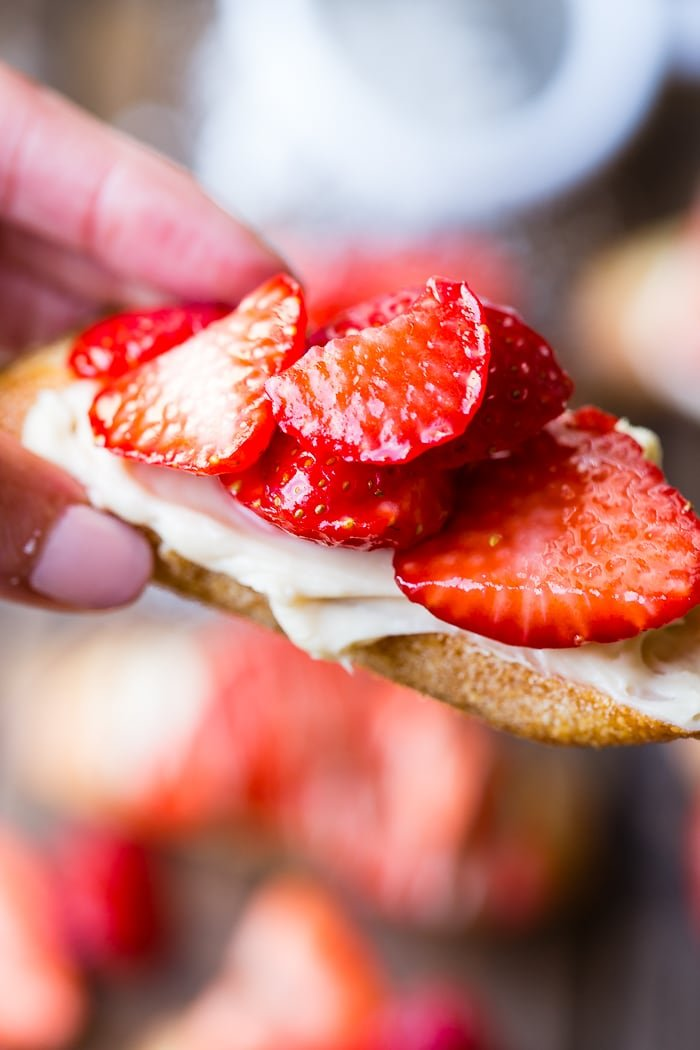 A brown board with brown sugar strawberry crostinis