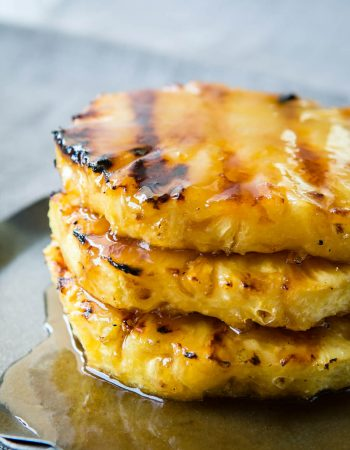 Juicy, sweet pineapple with a brown sugar butter sauce that's grilled to perfection. Looking for a healthier dessert? Try our brown sugar grilled pineapple! ohsweetbasil.com