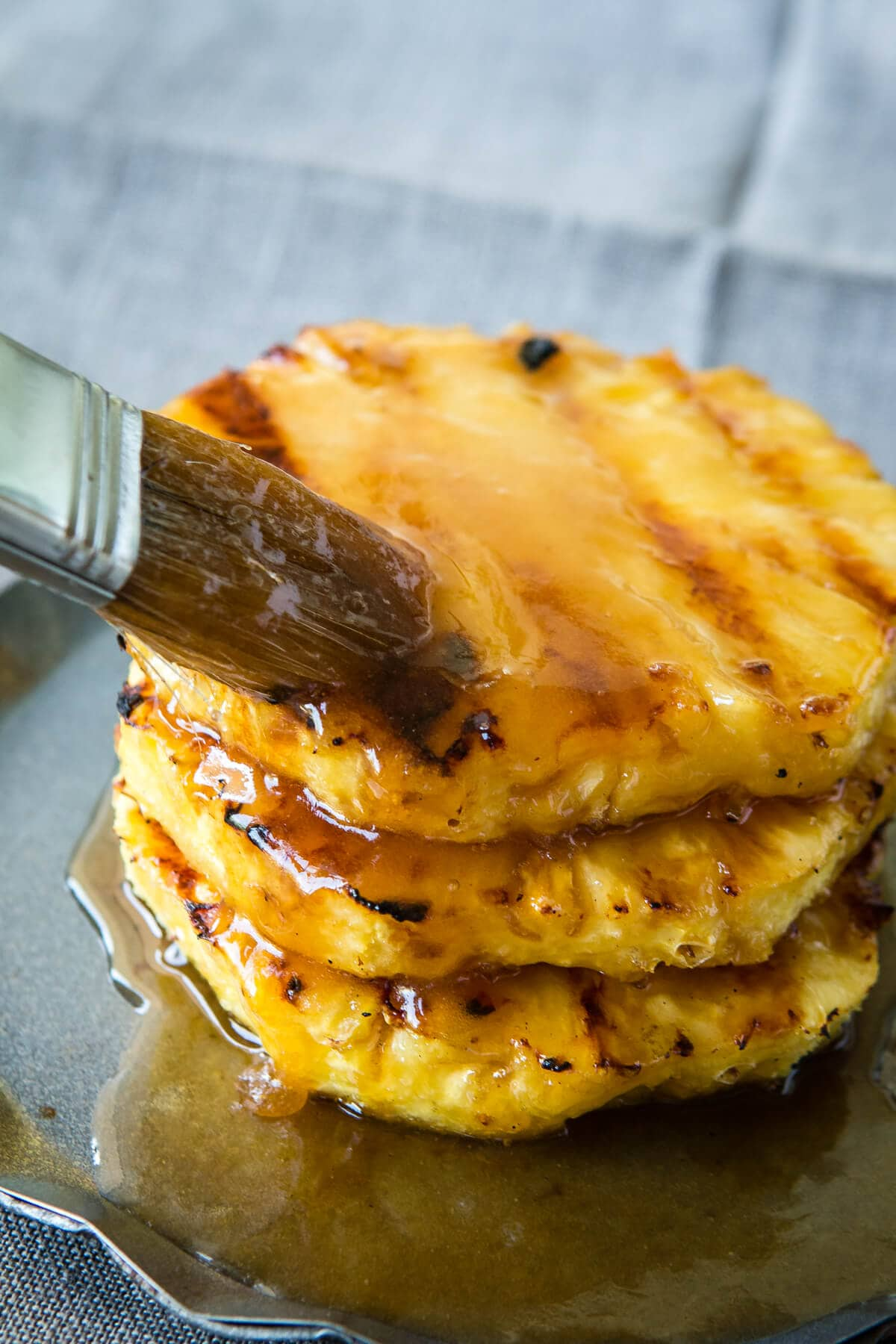Juicy, sweet pineapple with a brown sugar butter sauce that's grilled to perfection. Looking for a healthier dessert? Try our brown sugar grilled pineapple!