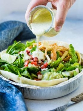 Looking for a Cafe Rio Copycat Tomatillo Ranch Dressing? This one has that cilantro lime ranch flavor everyone loves just like the restaurant! ohsweetbasil.com