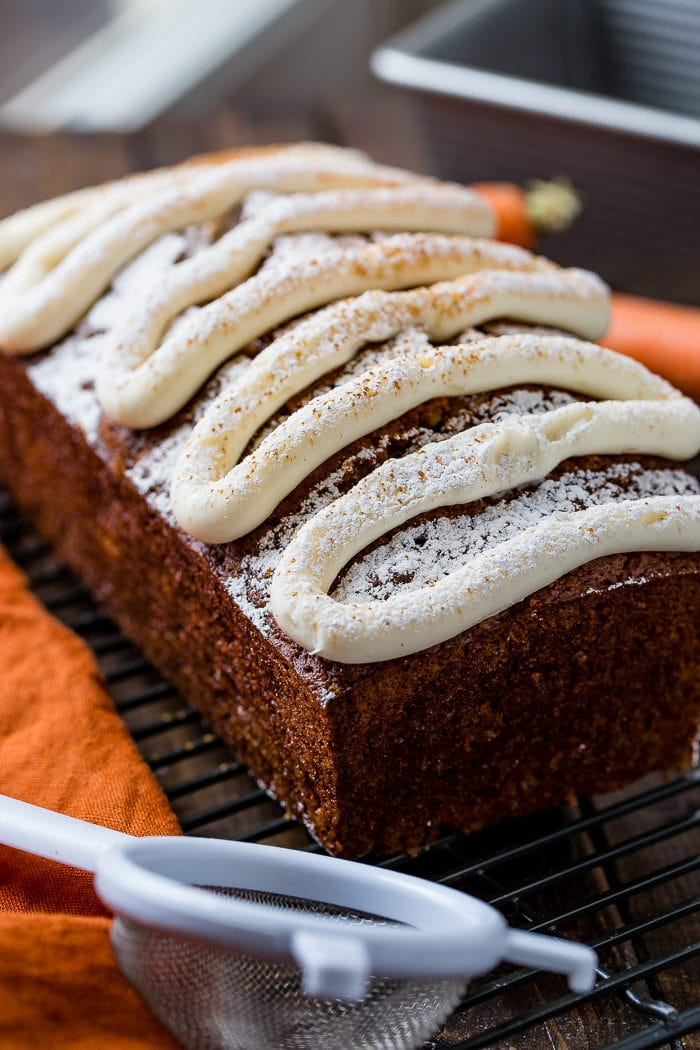 Moist and spicy carrot cake banana bread with cream cheese frosting and all the secrets to making banana bread ohsweetbasil.com
