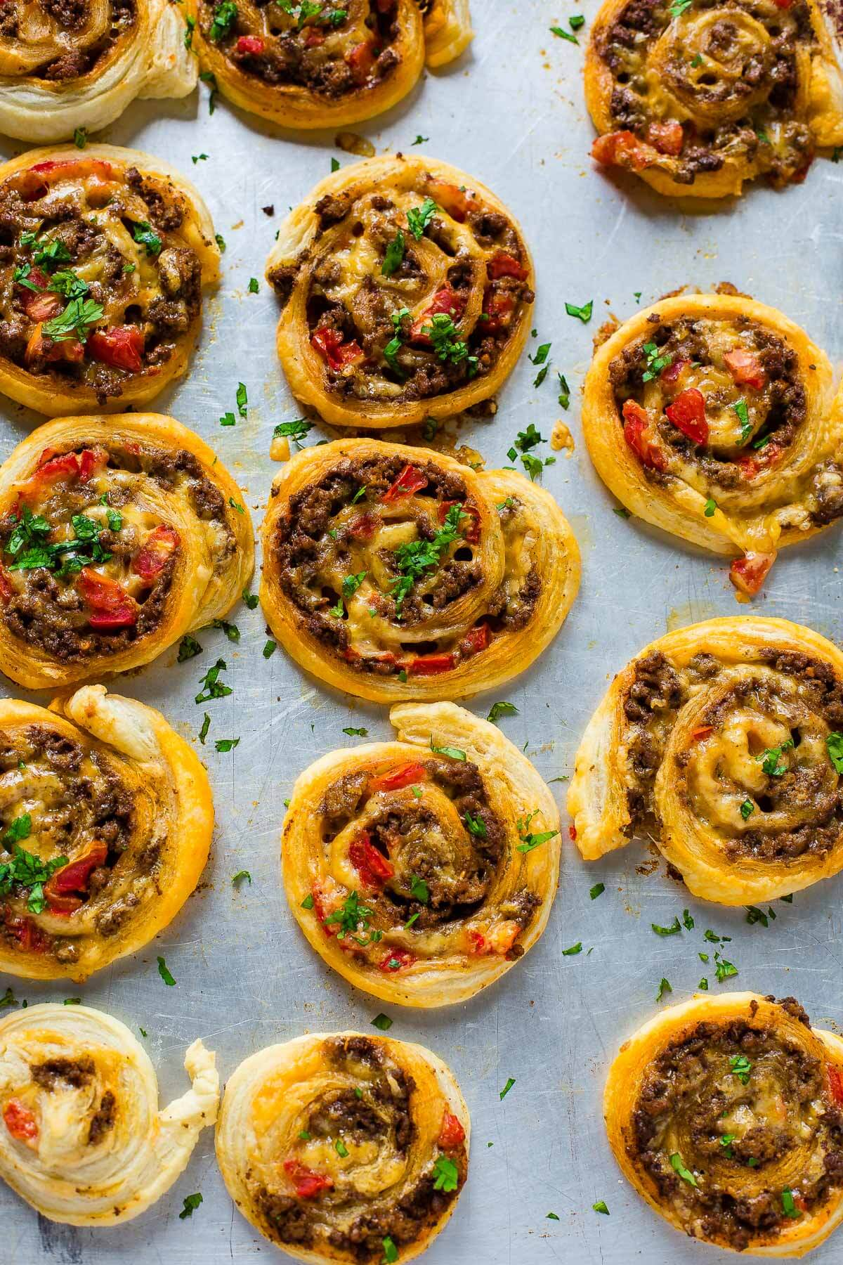 Looking for a quick and easy appetizer for football? Taco pinwheels- touchdown! ohsweetbasil.com