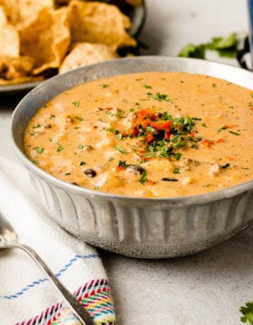 This is the most amazing cheesy ground beef enchilada soup, full of potatoes, beans, corn and ohhhh that cheesy goodness! ohsweetbasil.com