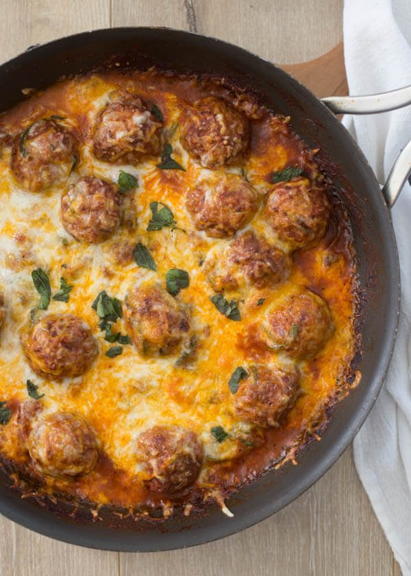 Want a quick and easy healthy dinner recipe? This cheesy meatball zucchini skillet is a one pot wonder and the whole family, yes even your picky eaters will be happy. ohsweetbasil.com