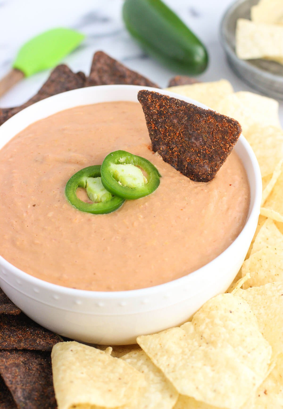 This cheesy salsa bean dip is a dip recipe perfect for entertaining! It's easy, cheesy, and just thick enough for a satisfying and customizable appetizer or snack.