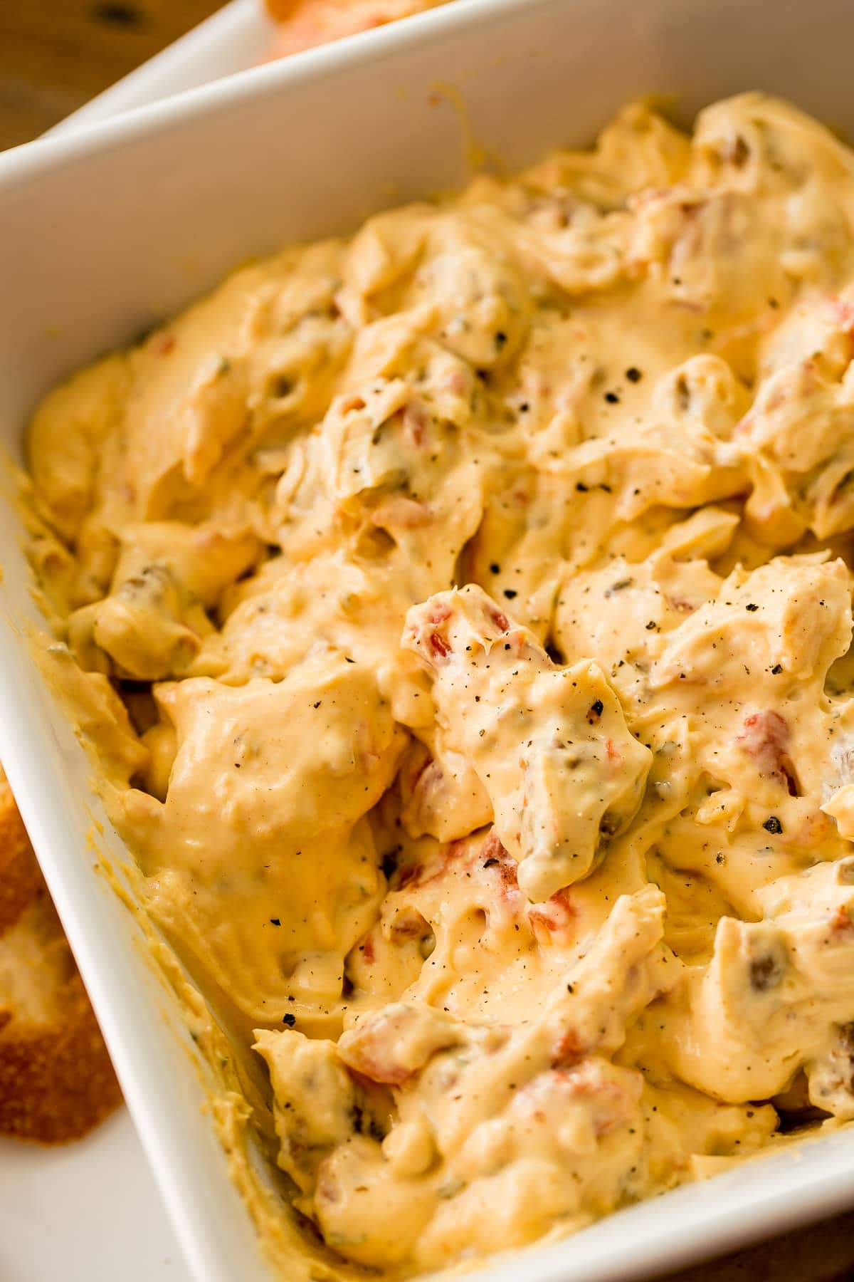 Throw tomatoes, ranch dip, cheese, cream cheese and sausage in a slow cooker and you've got cheesy slow cooker sausage dip! ohsweetbasil.com