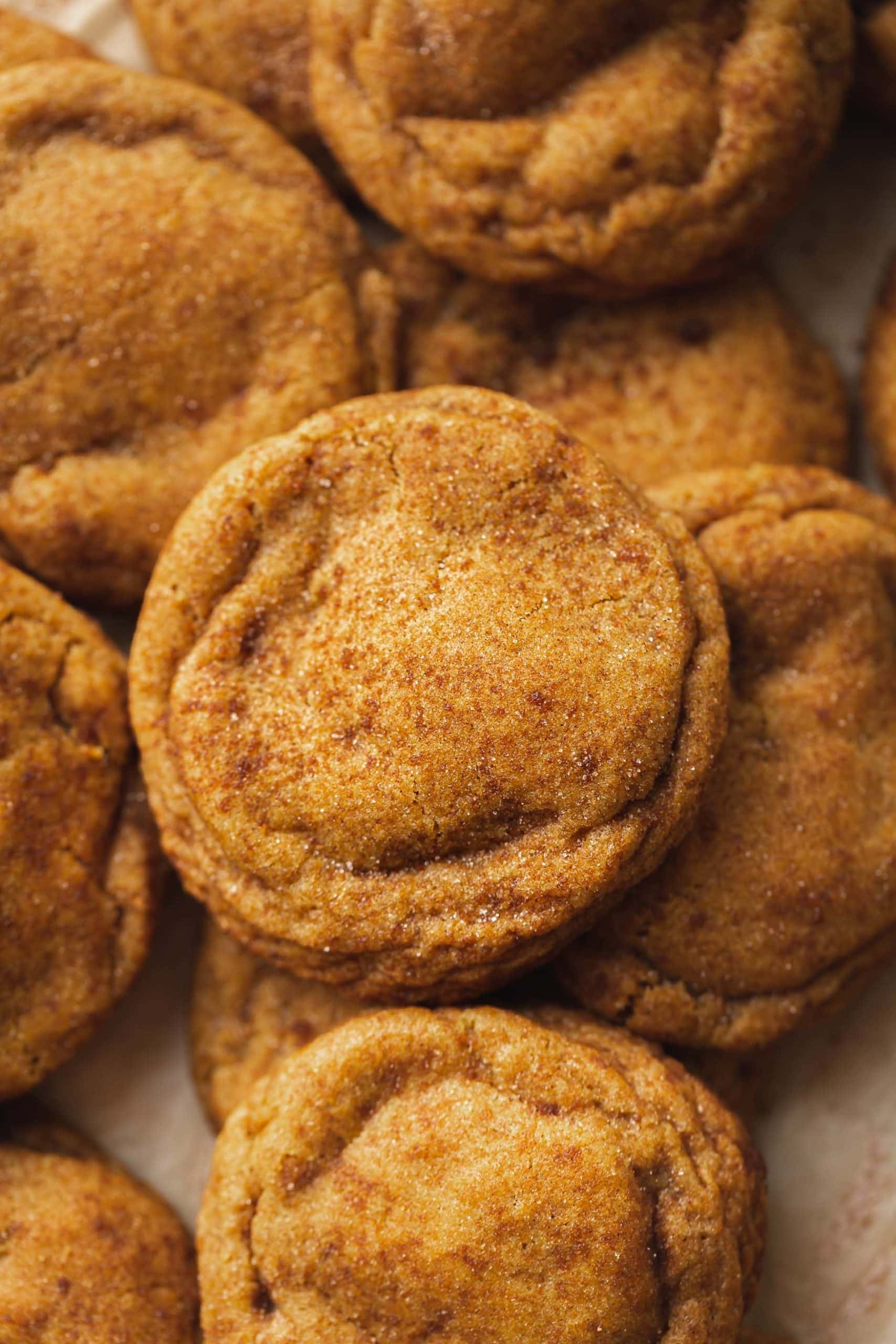A picture of chewy pumpkin cookies with brown sugar and cinnamon on top.