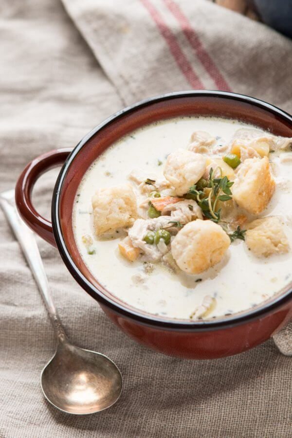 Take your favorite comfort food and turn it into the best cold weather soup ever, chicken pot pie soup! We even made some fluffy little biscuits to throw on top like you would crackers.